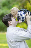 Middle aged man holding baby boy Royalty Free Stock Photo