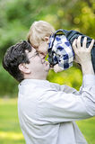 Middle aged man holding baby boy Stock Image