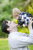 Middle aged man holding baby boy Stock Photography