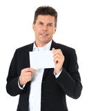 Middle-aged man holding blank white card Royalty Free Stock Photography