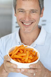 Middle Aged Man Holding A Bowl Of Carrots Stock Images