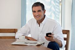 Middle Aged Man Holding Cell Phone Stock Images
