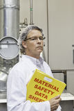 Middle-aged man holding data sheets of factory Stock Photo