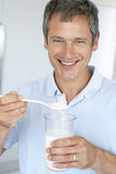 Middle Aged Man Holding Dietary Supplements Royalty Free Stock Photos