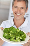 Middle Aged Man Holding A Plate Of Broccoli Royalty Free Stock Images
