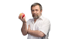 Middle-aged man holding a red apple Stock Images