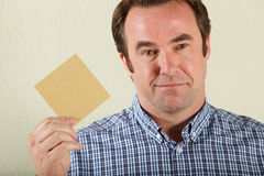 Middle Aged Man Holding Wage Packet Stock Photo