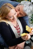 Middle Aged Man Kissing Woman Royalty Free Stock Image