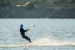 Middle aged man on a kiteboard stock images