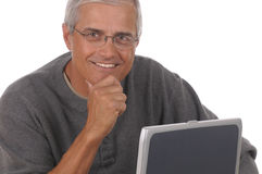 Middle Aged Man and Laptop Royalty Free Stock Photography