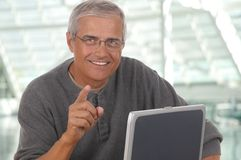 Middle Aged Man Laptop Pointing Stock Images