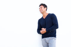 Middle aged man laughing against isolated white background. Portrait of a middle aged man laughing against isolated white background Stock Photography