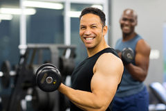 Middle aged man lifting weights Royalty Free Stock Photography