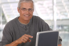 Middle aged man in lobby of modern office Royalty Free Stock Photos