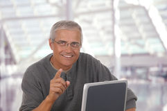 Middle aged man in lobby of modern office Royalty Free Stock Photo