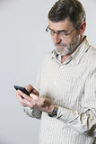 Middle aged man looking at his phone Stock Photos