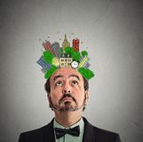 Middle aged man looking up city plan above head Royalty Free Stock Photos