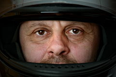 Middle aged man with motorcyclist helmet Royalty Free Stock Photos