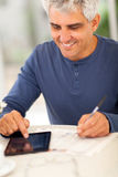Middle aged man newspaper Stock Image