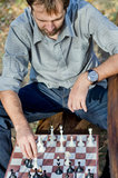 Middle aged man playing chess Stock Images