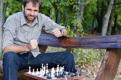 Middle aged man playing chess Stock Photo