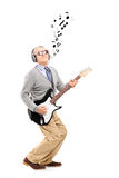 Middle aged man playing guitar and musical notes around royalty free stock photos