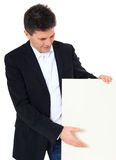 Middle-aged man pointing at blank sign Stock Photos