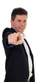 Middle aged man pointing with finger Stock Images