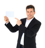 Middle-aged man points at blank white card Stock Image
