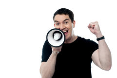 Middle aged man posing with megaphone Royalty Free Stock Image