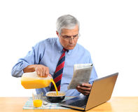 Middle Aged Man Pouring Milk into His Cereal Bowl. Middle aged man pouring Orange Juice into his breakfast cereal bowl instead of milk . He is in front of his Stock Image