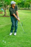 Middle-aged man practicing golf Royalty Free Stock Images