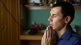 Middle-aged man praying god religion a indoor. Middle-aged man praying god religion indoor stock video footage