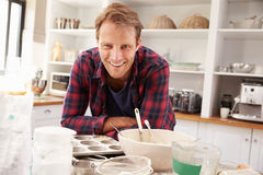 Middle aged man preparing to bake Royalty Free Stock Images