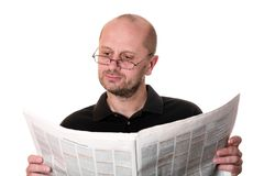 Middle aged man reading newspaper Stock Image