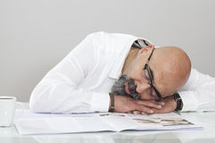 Middle aged man reading newspaper Stock Photos