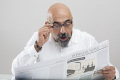 Middle aged man reading newspaper Royalty Free Stock Images