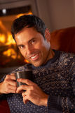 Middle Aged Man Relaxing With Hot Drink Royalty Free Stock Photo