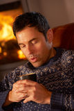 Middle Aged Man Relaxing With Hot Drink Royalty Free Stock Images