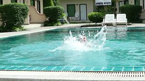 Middle-aged man relaxing and slowly swims in hotel swimming pool. Middle-aged man relaxing and slowly swims in hotel swimming pool stock video footage