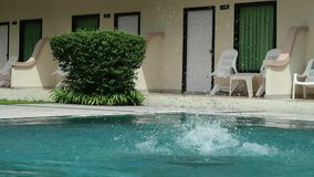 Middle-aged man relaxing and slowly swims in hotel swimming pool. Middle-aged man relaxing and slowly swims in hotel swimming pool stock footage