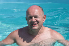 Middle-aged man relaxing in swimming pool, closeup Royalty Free Stock Photography