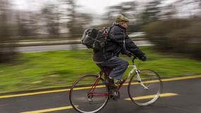 Middle-aged man rides bicycle on the cycling track in Bourgas / Bulgaria / 03.05.2018 / stock images