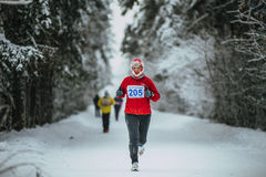 Middle-aged man runner while running in cold weather stock images