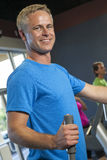 Middle Aged Man Running on Gym Exercise Machine Stock Photo