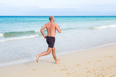 Middle aged man running stock photography