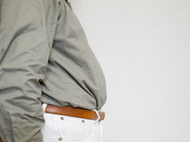 Middle aged man's abdomen. Midsection of middle aged man's fat abdomen Royalty Free Stock Photos