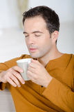 Middle-aged man savouring aroma cup coffee Royalty Free Stock Photography