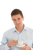 Middle-aged man savouring the aroma of a cup of fresh hot coffee. Good looking middle-aged man savouring the aroma of a cup of fresh hot coffee during a business Stock Image