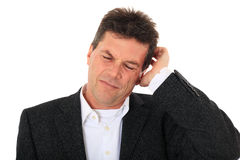 Middle-aged man scratching his head Royalty Free Stock Images